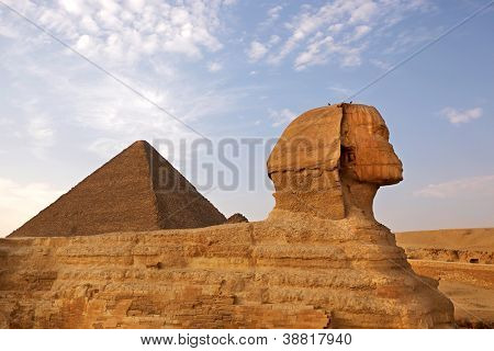 Sphinx and Pyramid Giza, Egypt. The Great Pyramid of Giza is one of the original Seven Wonders of the World.