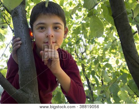 young boy with finger on his mouth