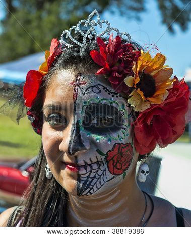 "OCEANSIDE, CALIFORNIA - OCTOBER 28: An unnamed woman with a painted face at the Dia De Los Muertos ""Day of the Dead"" on October 28, 2012 in Oceanside, California."