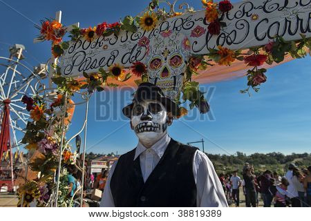 "OCEANSIDE, CALIFORNIA - OCTOBER 28: An unnamed man with a painted face at the Dia De Los Muertos ""Day of the Dead"" on October 28, 2012 in Oceanside, California."