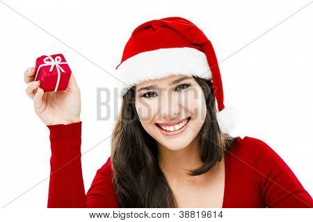 Beautiful asian woman wearing Santa's hat holding a small christmas gift, isolated on white