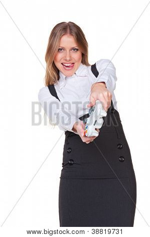 excited businesswoman playing a video game. studio shot over white background