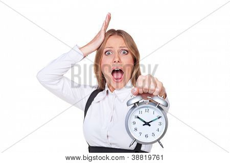 shocked young businesswoman holding the alarm clock. isolated on white background