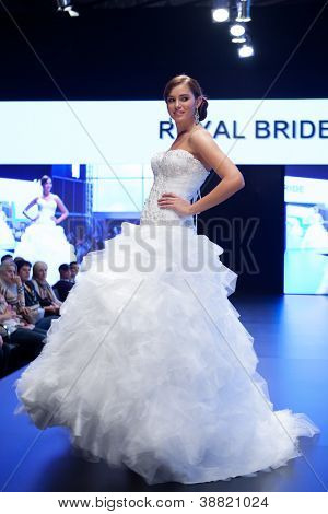 ZAGREB, CROATIA - OCTOBER 27: Fashion model in wedding dress walks on the catwalk during the Zagreb Bridal show, on October 27, 2012 in Zagreb, Croatia.