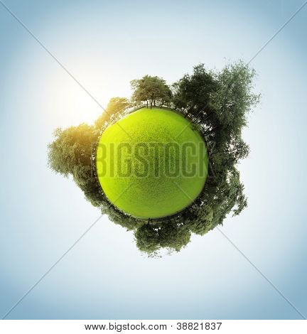 Green little planet with trees meadow and clear sky with sun