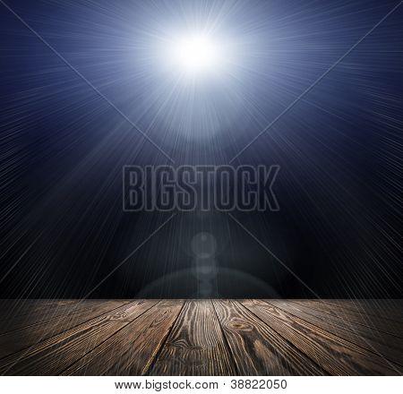 Spot lighting over dark background and wood floor. concert