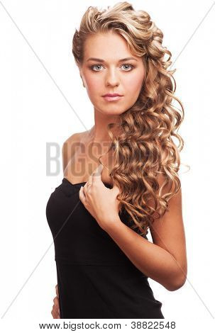 Portrait of  attractive young woman with long blond hair and beautiful stylish hairstyle. Isolated on white background