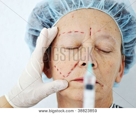 Elderly woman getting Botox injection surgery operation