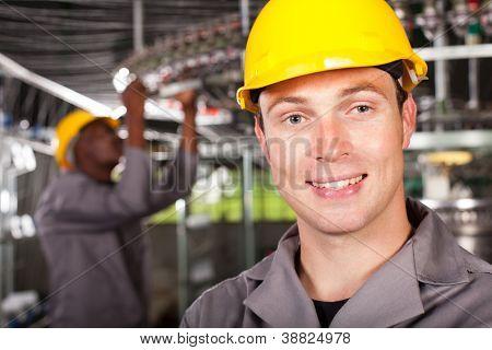 industrial worker closeup portrait in factory