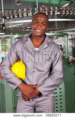 african american blue collar industrial worker in factory
