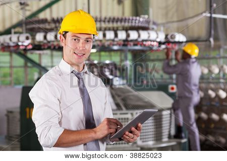 modern textile factory manager using tablet computer