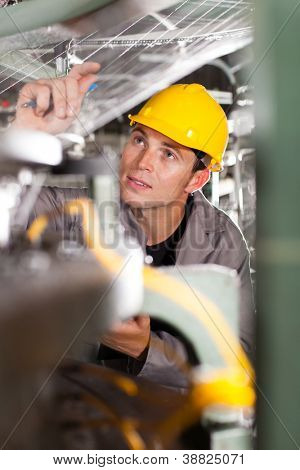 textile worker conducting industrial quality control