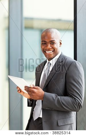 happy african american entrepreneur using tablet computer