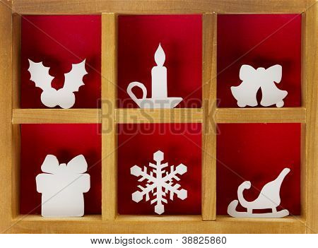 Christmas decoration hand cut and crafted from paper, wooden printer tray.