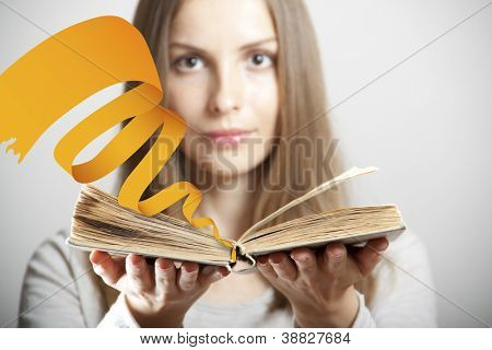 Young woman with old book