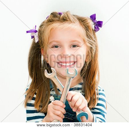 little smiling girl with a chrome spanners