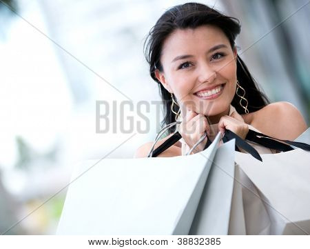 Woman on a shopping spree looking very happy