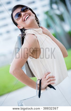 Excited woman on a shopping spree looking very happy
