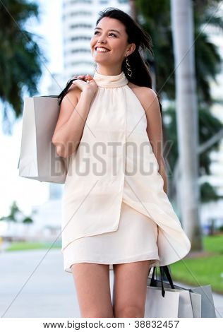 Beautiful woman on a shopping spree carrying bags