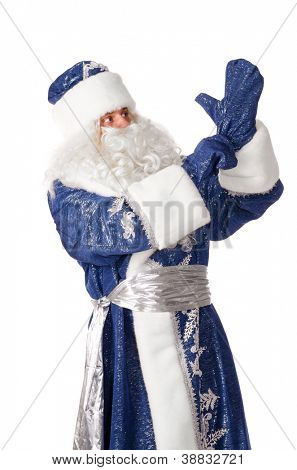 santa claus is putting on gloves, isolated on white