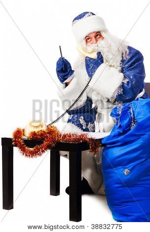 santa claus is receiving christmas wishes by phone, isolated on white