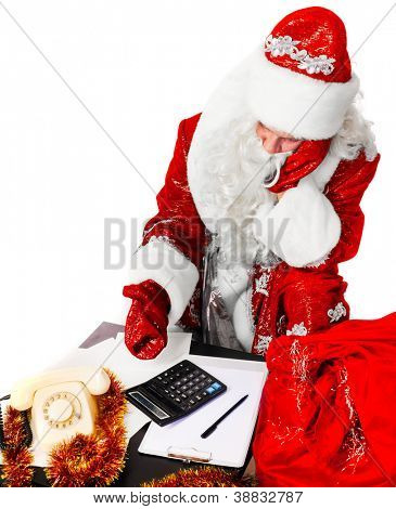 santa claus is calculating his expenses, isolated on white
