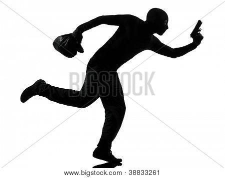 thief criminal running in silhouette studio isolated on white background