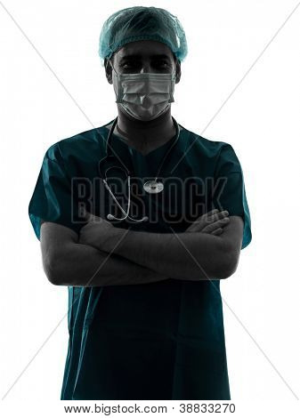 one caucasian doctor surgeon man portrait with face mask medical worker arms crossed silhouette isolated on white background