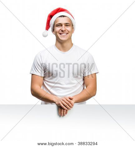 young man in a Santa Claus hat behind the white board with space for text