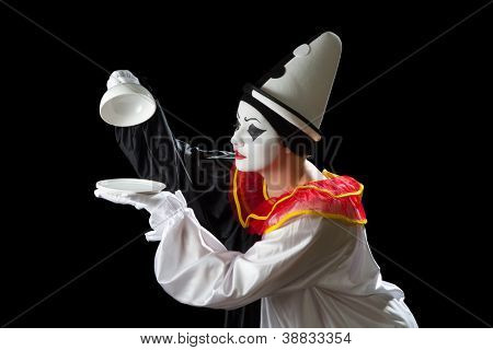 Surprised Pierrot clown uncovering an empty tray dish