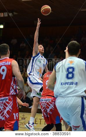 KAPOSVAR, HUNGARY - OCTOBER 20: Roland Hendlein (white 11) in action at Hungarian Championship basketball game with Kaposvar (white) vs. Nyiregyhaza (red) on October 20, 2012 in Kaposvar, Hungary.