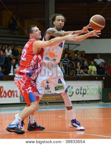KAPOSVAR, HUNGARY - OCTOBER 20: Kyle Swanston (in white) in action at Hungarian Championship basketball game with Kaposvar (white) vs. Nyiregyhaza (red) on October 20, 2012 in Kaposvar, Hungary.