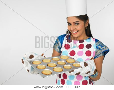Asian Female Baker With A Plate Of Cookies
