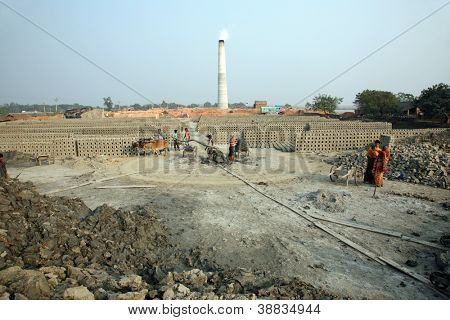 SARBERIA,INDIA, JANUARY 16:A Brickfield is a large area, used for manufacturing bricks from mud, clay and sand. Machines for making bricks are very rudimentary,Jan 16,2009 in Sarberia,W. Bengal,India.