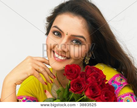 Woman Of Indian Origin With A Bouquet Of Roses