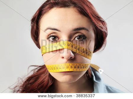 Woman with a meter that shuts her mouth