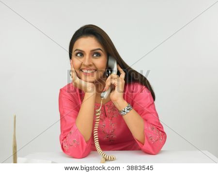 Young Asian Female Executive On The Phone