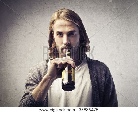 Blonde guy drinking a beer