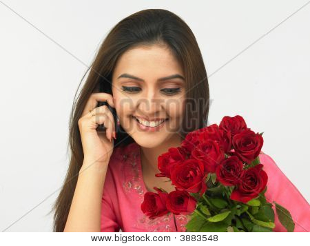 Asian Woman Talking On Her Cell Phone