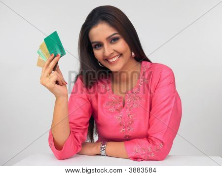 Beautiful Young Asian Woman With A Credit Cards