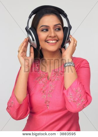 Asian Woman Wearing A Headphone