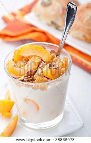 yogurt with muesli and apricot in small glass