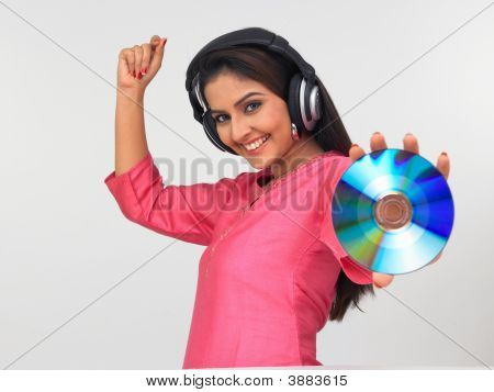 Young Asian Woman Of Indian Origin Enjoying Music