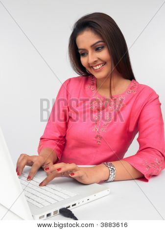 Young Asian Woman Working In Her Laptop