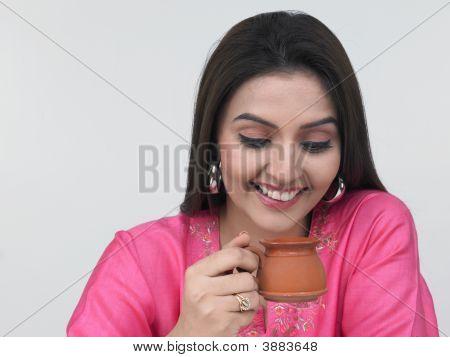 Beautiful Young Asian Woman Drinking Coffee