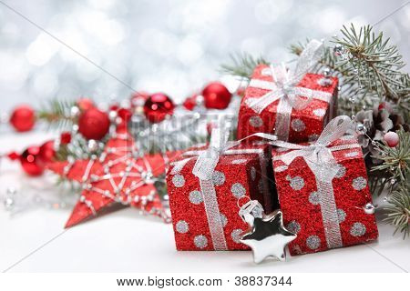 Closeup of gift boxes and pine branch on abstract background.