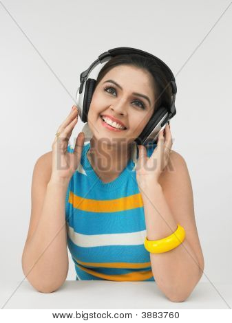 Young Asian Woman With Headphones Listening To Music