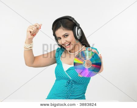 Beautiful Young Asian Female Enjoying Music