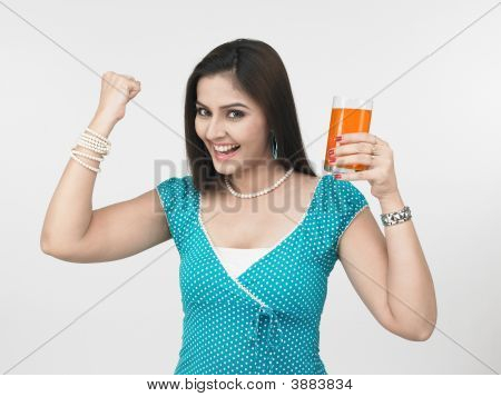 Asian Woman Of Indian Origin Drinking Orange Juice