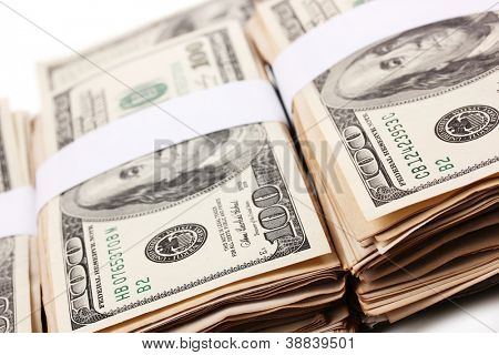 Many one hundred dollars banknotes close-up isolated on white